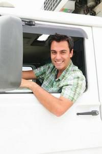 Man leaning out of vehicle smiling
