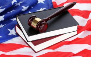 US flag with book and gavel
