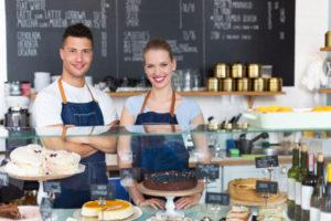 Cake shop staff smiling