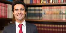 Attorney Smiling in a law library